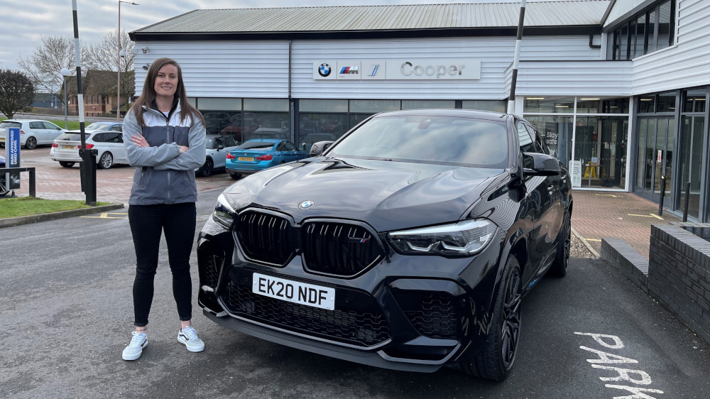 Abbie Eaton collects BMW X6M from BMW Inchcape